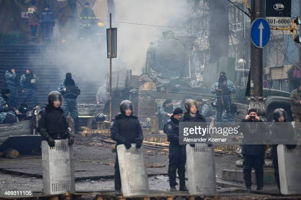 Berkut special riot police forces watch a mass at the barricade on Grushevskogo Street on February 14 2014 in Kiev Ukraine Russian Foreign Minister...