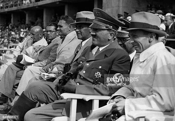 Berlin 1936 Olympics Adolf Hitler on the rostrum at the stadium next to right Joseph Goebbels to the left the Minister of the Interior of the Third...