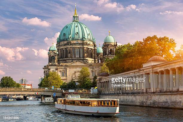 berlin, a tour boat on the spree river - central berlin stock photos and pictures