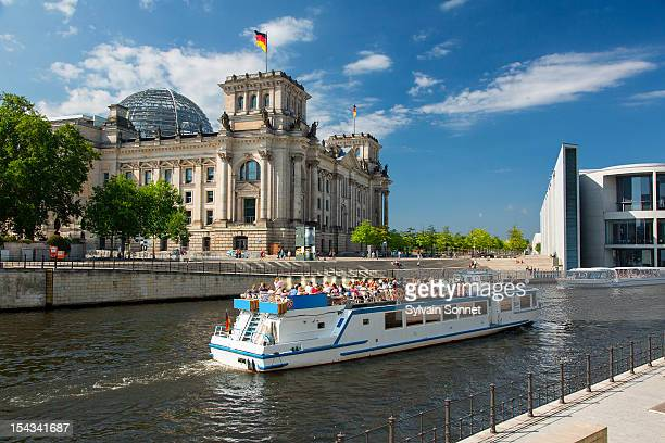 berlin, a tourboat on the spree river - spree river stock pictures, royalty-free photos & images