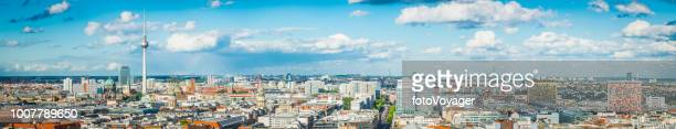 berlin aerial panorama over fernsehturm rooftops and mitte landmarks germany - berlin stock pictures, royalty-free photos & images