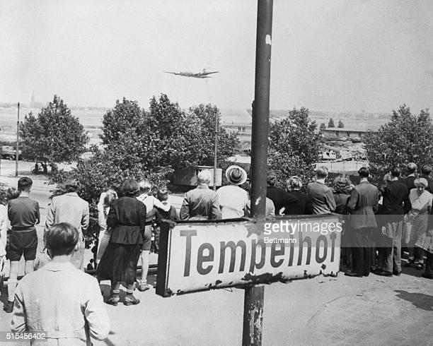 Berlin Airlift Berlin citizens watching plane land at Tempelhof