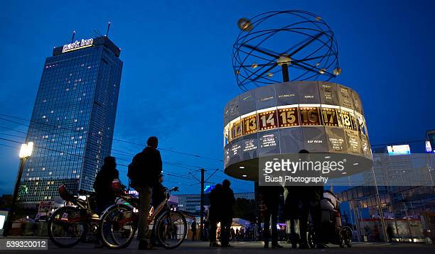 Berlin Alexanderplatz night Scene, with the Weltzeituhr (World Time Clock), built in 1969, and the Park Inn Hotel highrise in the background