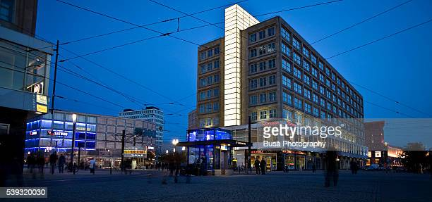 Berlin Alexanderplatz, scene at twilight / night, with the Alexanderhaus and Berolinahaus built in the 1930s by architect Peter Behrens