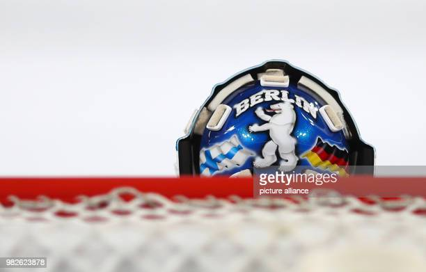 Berlin and a bear on the helmet of Berlin goalie Petri Vehanen with the flags of Finland and Germany at the DEL ice hockey match between Nuernberg...