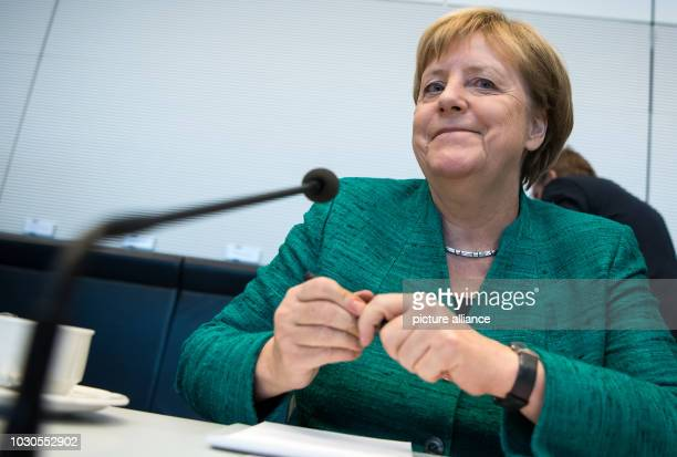Angela Merkel Chancellor and Chairwoman of the Christian Democratic Union sits in the German Bundestag at the beginning of the session of the CDU/CSU...