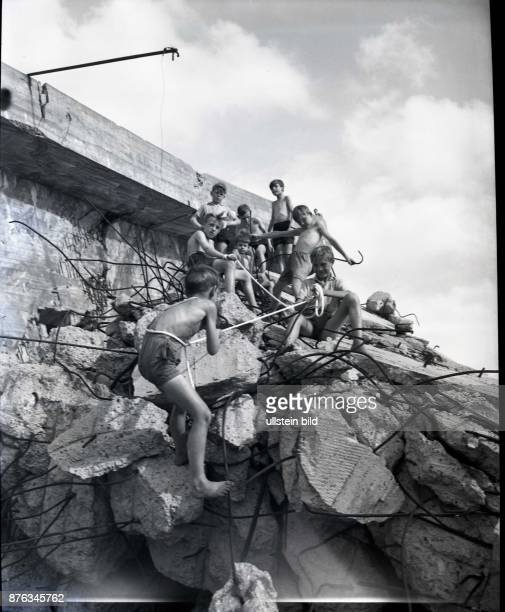 Berlin Blockade: children are playing in the lake Neuer See in Tiergarten at the ruin of a bunker