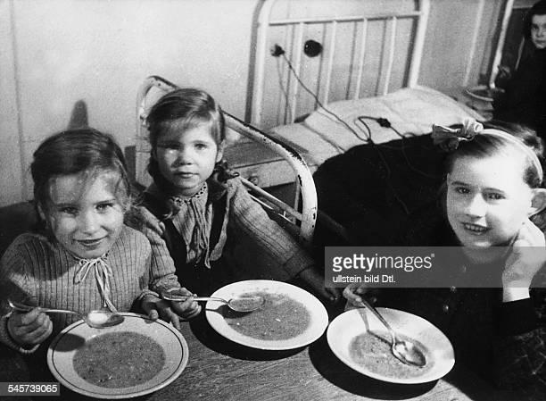 Berlin Blockade Children of Berlin having a meal at a children's home in Hamburg
