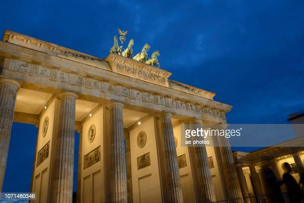berlin, brandenburg gate at dusk - central berlin stock photos and pictures