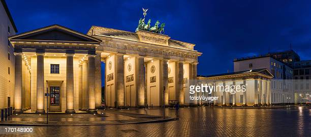 berlin brandenburg gate landmark panorama illuminated at dusk germany - east berlin stock photos and pictures
