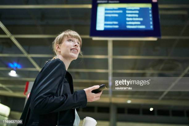 berlin businesswoman with smart phone commuting to work - mid adult stock pictures, royalty-free photos & images