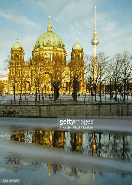 Berlin Cathedral And Fernsehturm In Front Of Frozen River