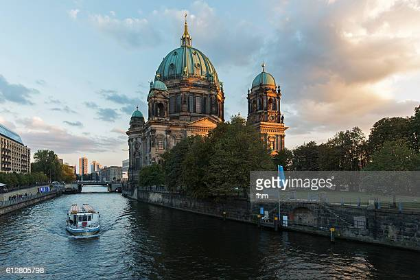 Berlin cathedral with a sightseeing boat on Spree river