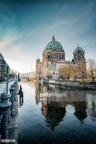 berlin cathedral with reflection in river at morning hour - berlin stock pictures, royalty-free photos & images