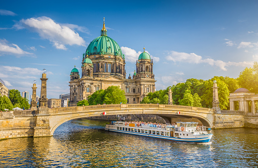 Berlin Cathedral with ship on Spree river at sunset, Berlin, Germany 907886562