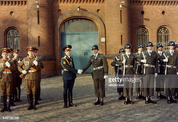 changing of the guard in front of the war criminal prison