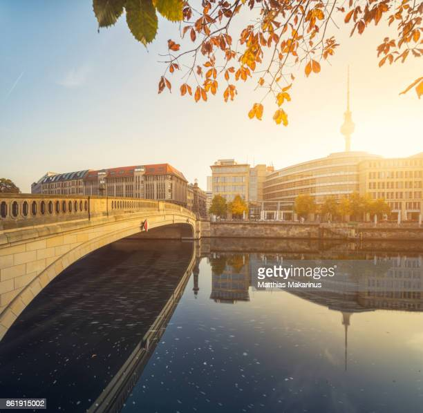 Berlin City Autumn Skyline with Spree River Reflection and Sunlight