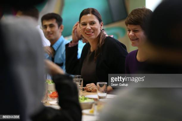 Berlin city Education Senator Sandra Scheeres sits down to eat lunch with teenaged refugees at the extracurricular Germanlanguage program the...