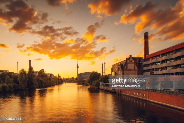 berlin city modern business golden summer spree skyline with sunset and reflection - spree river stock pictures, royalty-free photos & images