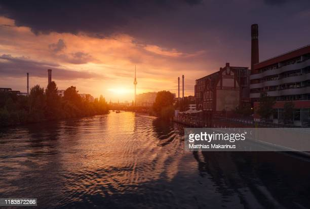 berlin city modern business summer spree skyline with sunset and reflection - spree river stock pictures, royalty-free photos & images