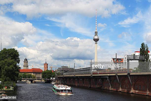 Berlin city sightseeing - skyline with tourist boat and TV-Tower near Spree river