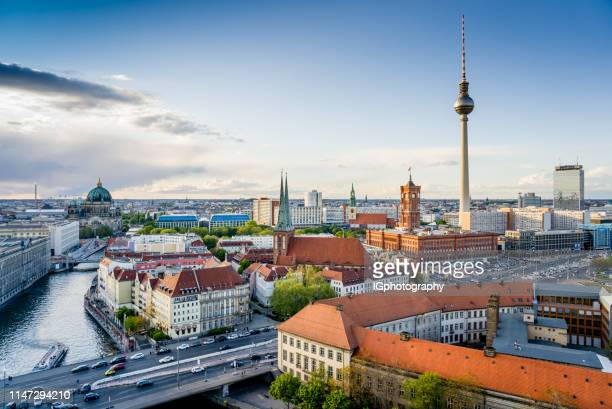 berlin city skyline with the iconic tv tower and the river spree - television tower berlin stock pictures, royalty-free photos & images