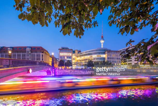 berlin city summer skyline with dynamic lightship on spree river - makarinus stock photos and pictures