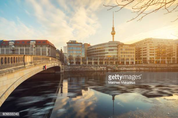 Berlin City Winter Skyline with Spree River Reflection and Sunlight