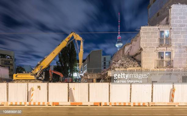berlin demolishing night skyline szene with dramatic clouds and tv tower - construction barrier stock pictures, royalty-free photos & images