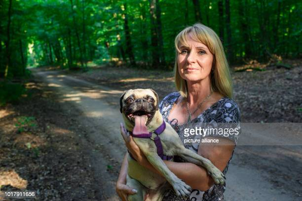 Dog owner Angela Kaiser holds her old German pug Emma in her arms in a forest near Hermsdorf With a time of less than six seconds Pug Emma was the...