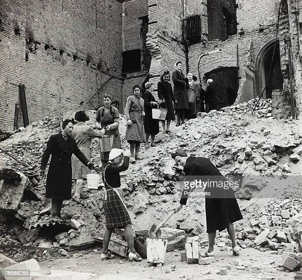 Berlin East Germany German women clearing up debris and rubble during the clean up in Berlin after the devastation of World War Two