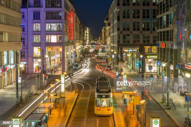 berlin friedrichstrasse at night (germany) - central berlin stock photos and pictures
