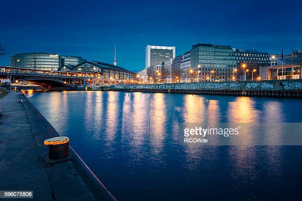 berlin friedrichstrasse with spree river after sunset