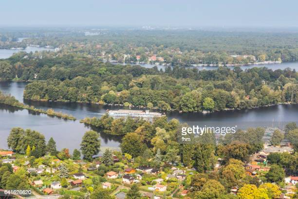 Berlin from a landing aircraft - Berlin Spandau, forest and Havel River with a sightseeing boat