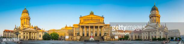 berlin gendarmenmarkt iconic historic square illuminated at sunrise panorama germany - berlin stock pictures, royalty-free photos & images