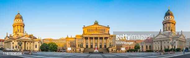 berlin gendarmenmarkt square panorama illuminated at sunrise germany - konzerthaus berlin stock pictures, royalty-free photos & images