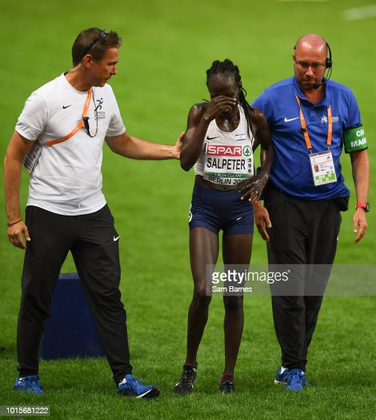Berlin Germany 12 August 2018 A dejected Lonah Chemtai Salpeter of Israel is helped from the track after she celebrated a lap prematurely during the...
