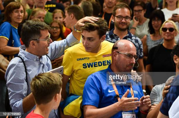 Berlin Germany 12 August 2018 Armand Duplantis of Sweden is congratulated by friends and family after winning the Men's Pole Vault during Day 6 of...