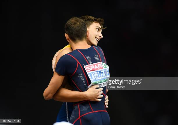 Berlin Germany 12 August 2018 Armand Duplantis of Sweden left is congratulated by Renaud Lavillenie of France after winning the Men's polevault...