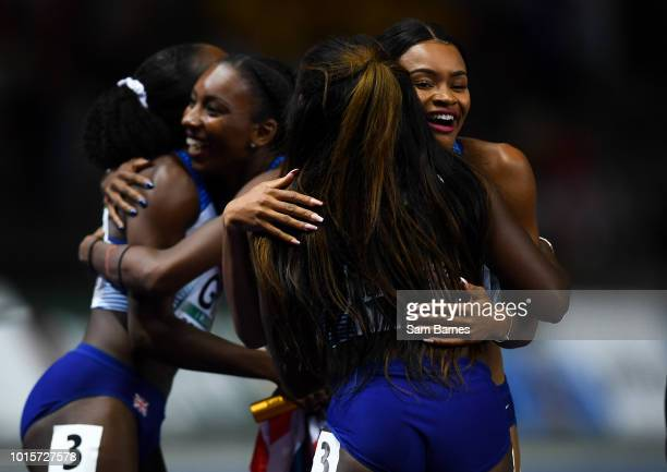 Berlin Germany 12 August 2018 Imani Lansiquot right and the Great Britain Women's 4x100m Relay team celebrate winning gold during Day 6 of the 2018...