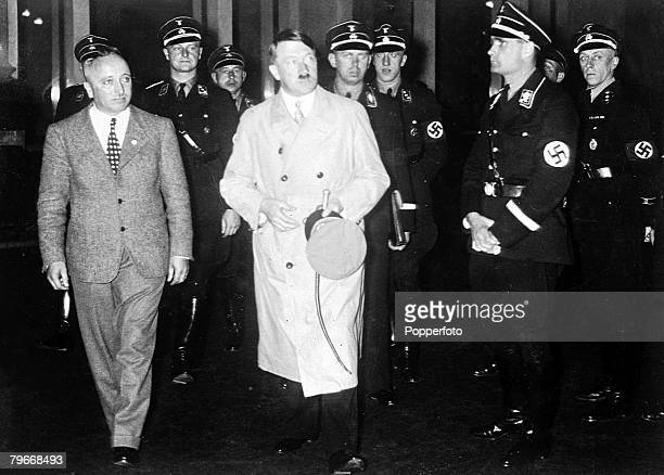 Berlin Germany 13th October Chancellor Adolf Hitler Nazi leader of Germany arrives for a meeting to address a group of Nazis accompanied by Dr Ley...