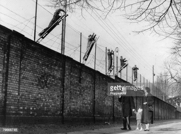 Berlin Germany 19th November East Berlin border guards adding barbed wire to the newly built Berlin Wall The wall was set up the Soviet army to...