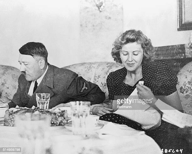 A candid photograph of Eva Braun with Adolf Hitler at the dining table This picture released by the U S Army Signal Corps was taken form the album of...