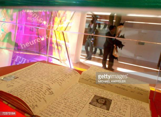 A copy of the diary of Anne Frank is seen at the just opened permanent exhibition 'Anne Frank here now' 03 November 2006 at the Anne Frank Zentrum in...