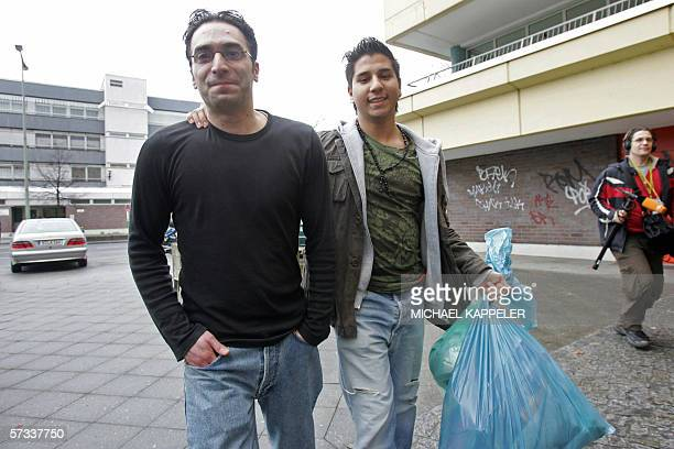 A Surucu brother of Ayhan Surucu who was convicted of murdering his sister in a socalled honor killing last year walks out of a Berlin court with an...