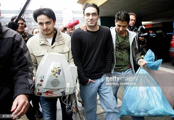 A Surucu brother of Ayhan Surucu who was convicted of murdering his sister in a socalled honor killing last year walks out of a Berlin court with...