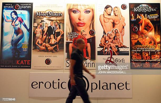 A visitor walks past a display of pornographic films at the 10th Venus International Erotic Trade Fair in Berlin 20 October 2006 The fair runs until...