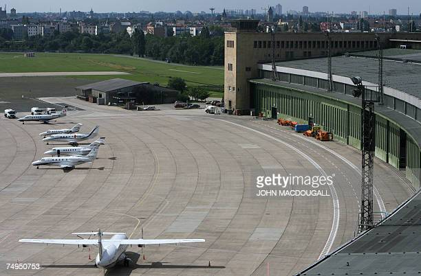 Aircraft, including private jets, are parked on the tarmac of Tempelhof airport in Berlin 29 June 2007. Tempelhof airport is expected to cease all...