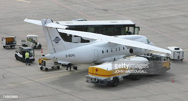 An aircraft is refuelled by a Shell truck on the tarmac of Tempelhof airport in Berlin 29 June 2007. Tempelhof airport is expected to cease all...
