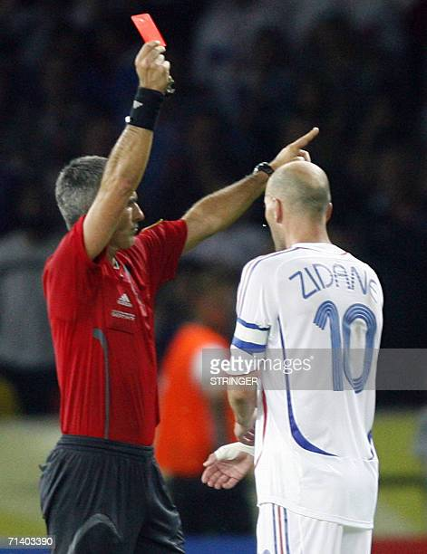 Argentinean referee Horacio Elizondo gives a red card to French midfielder Zinedine Zidane after he head butted Italian defender Marco Materazzi...